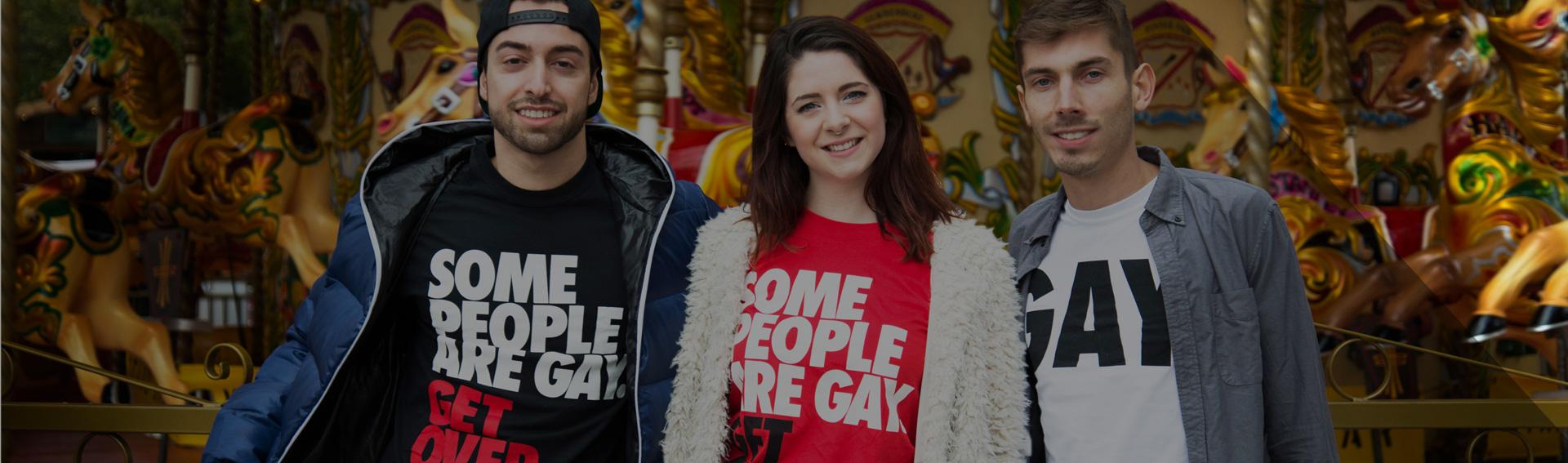 Three people modelling Stonewall t-shirts