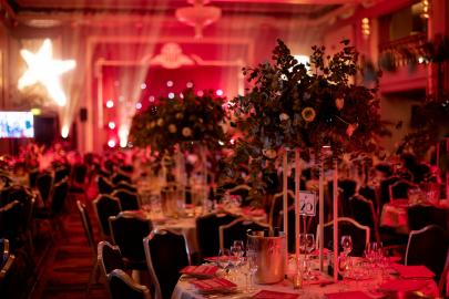 Flowers on elegant table set up with red lighting