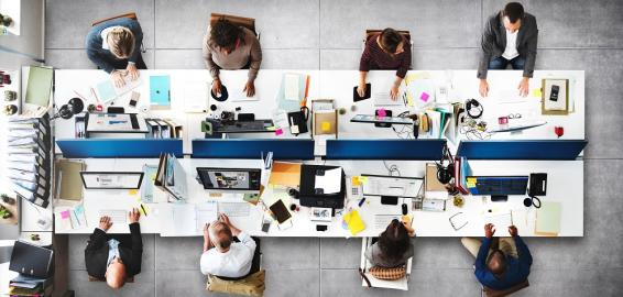 People on computers at workstation