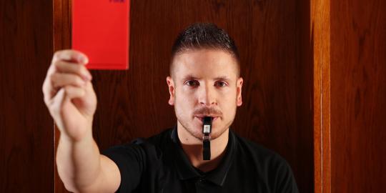 Referee holding a football