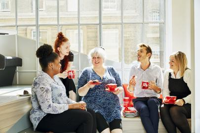 Group of people in an office drinking tea