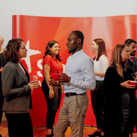 Large group of people mingling for fun at a professional event