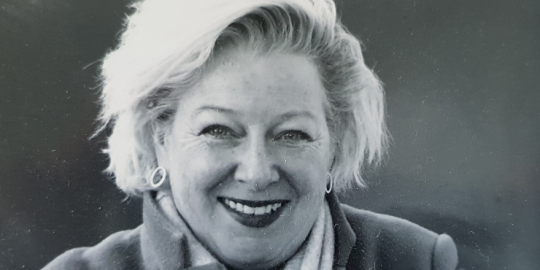 Woman in black and white photograph smiling