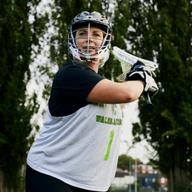 Woman playing lacrosse