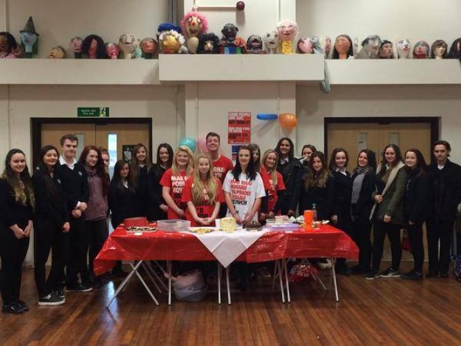 Stonewall Cymru fundraisers at a charity bake sale 2015
