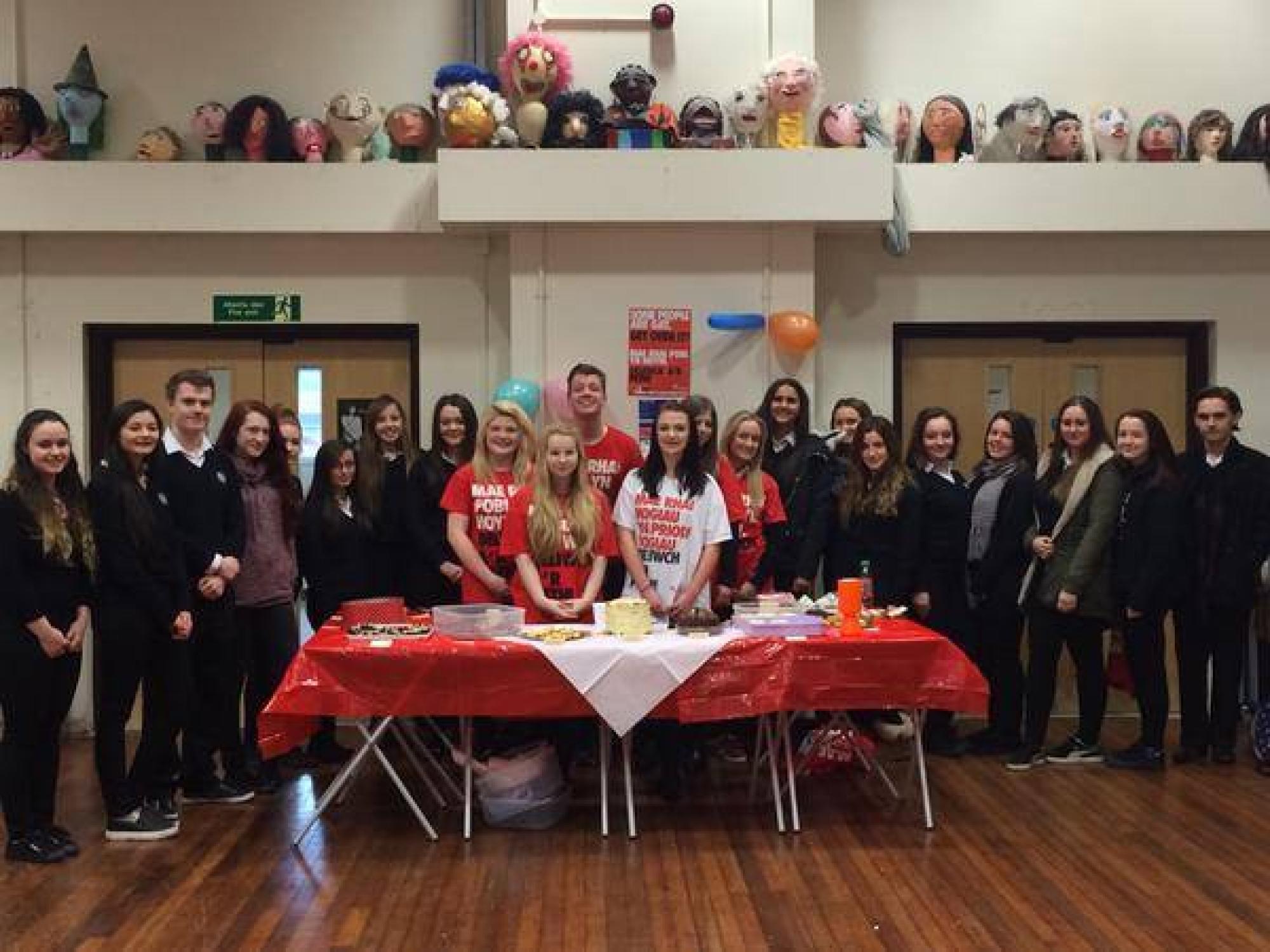 Stonewall Cymru fundraisers at a charity bake sale 2015