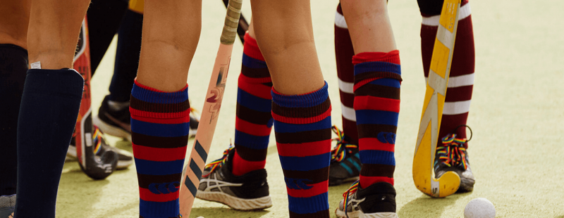 Group of young people playing sport wearing rainbow laces
