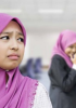 A young person in a hijab looking unhappy