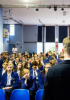 Photo of a role model talking to an assembly