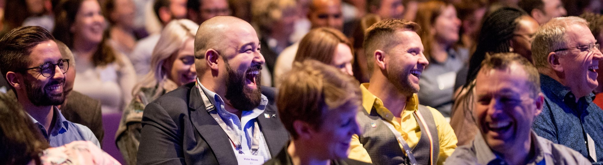 Audience laughing at conference